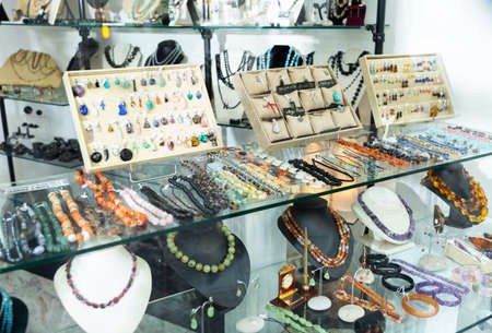 Gemstone jewellery on shelves of jewelry boutique