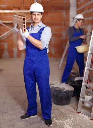 Two builders in work wear