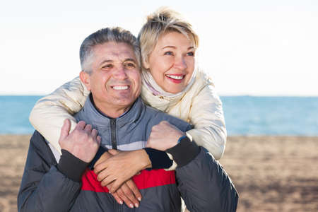 Mature couple relaxing on sea beach