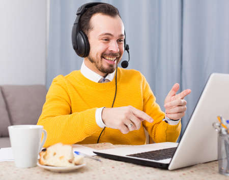 Man studying remotely at home