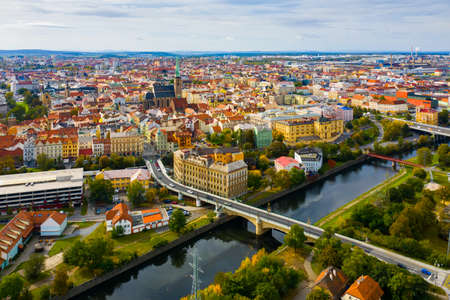 Picturesque aerial view of old buildings of Pilsen cityscape with river and ponds