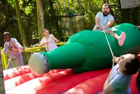 Glad man saddling inflatable rodeo bottle