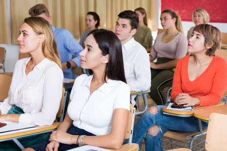 Young woman on lecture in classroom