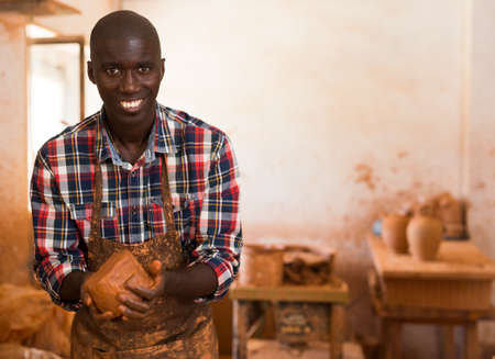 Craftsman moulding wet clay