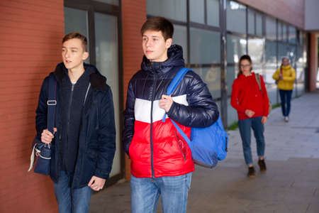Two teen students walking to college