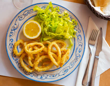 Crispy squid rings in batter Roman style. Traditional spanish dish