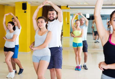 People dancing salsa in studio