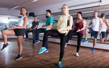 Dancers learning zumba elements in gymnastics hall Standard-Bild