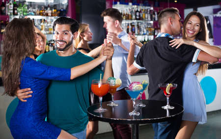 Couple dancing passionately in pair in the nightclub
