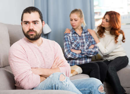Adult guy having argue with wife and mother-in-law
