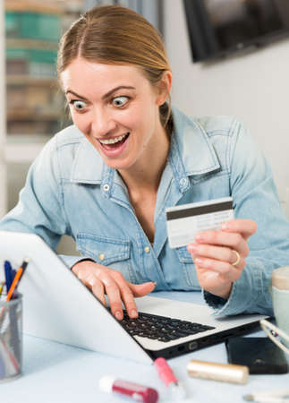 Excited woman shopping online