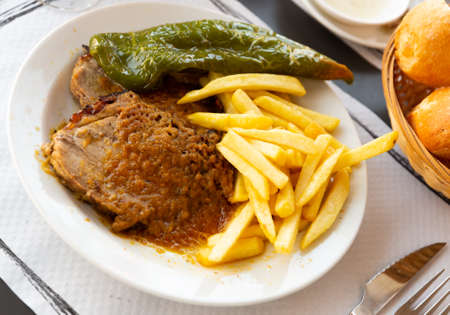 Grilled pork with french fries and pepper Foto de archivo