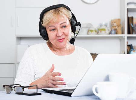 Mature woman communicates via the Internet Stock Photo
