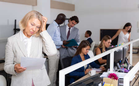 Confused adult woman office worker