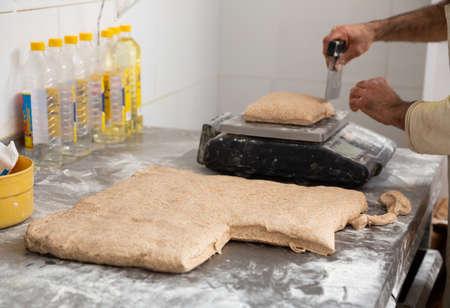Baker portioning dough