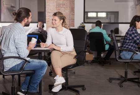 Man sharing business ideas with female colleague