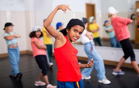 Happy tweens practicing hip hop in dance studio