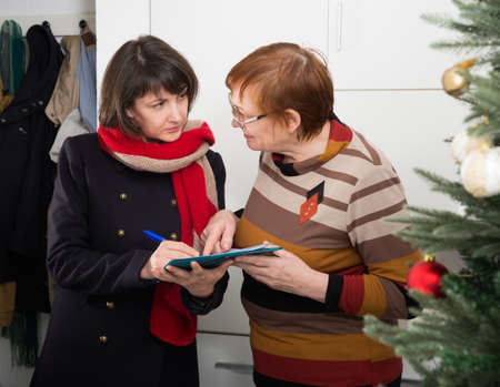 Mature woman participating in survey at home