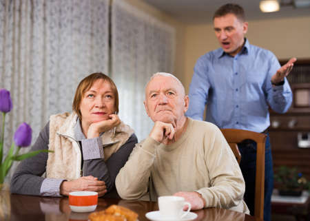 Adult son argues with his elderly parents at home