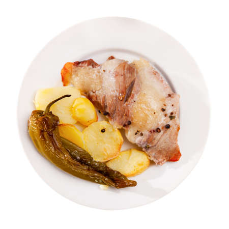 Tasty baked pork with potatoes and baked green pepper Stock fotó - 155449726