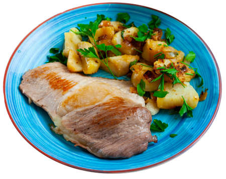 Fried Iberian pig served with potatoes Stock fotó - 155449728