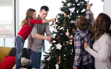 Cheerful family members preparing for Christmas Stock fotó