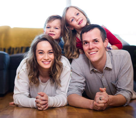 parents and vigorous children happy to spend time at home Stock fotó