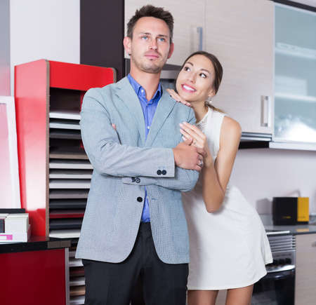 Pair standing in furniture accessories store Stock Photo
