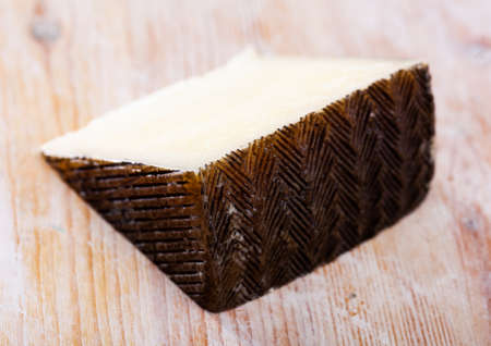 Piece of spanish hard cheese Anejo from sheep milk Stock Photo