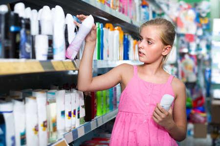 Teenage girl is choosing deodorant
