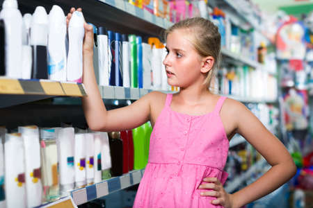 Girl is choosing deodorant