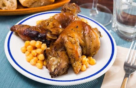 Spanish dish Pies de cerdo con garbanzos