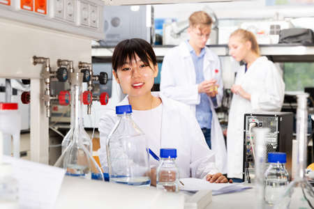 Female Chinese chemist working in laboratory