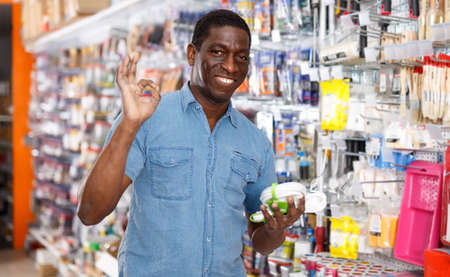Glad African American man with purchases