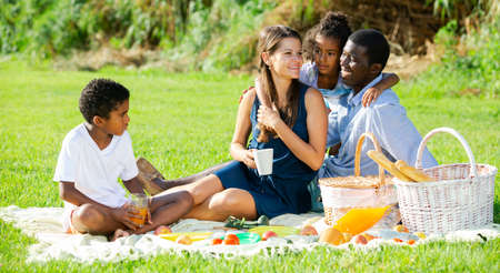 Couple with children at picnic Stockfoto