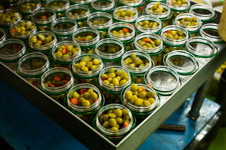 Olives and other ingredients in glass jars for canning
