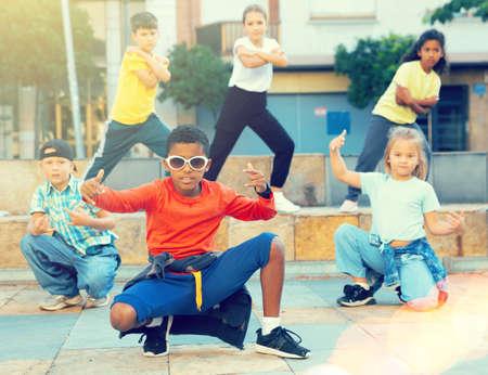 Tweens dancing hip-hop on summer street