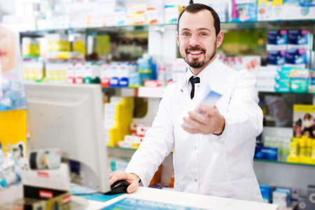 Pharmacist writing down assortment of drugs