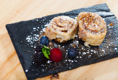 Cinnabons served with fresh berries