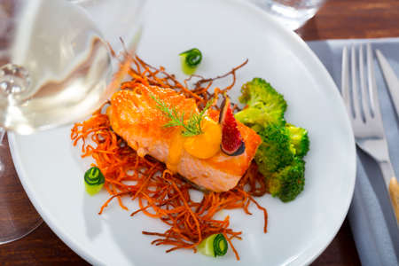 Fried salmon with smoked julienne carrot, broccoli, cucumber, figs