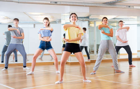 Teenage dancers practicing new dance in studio