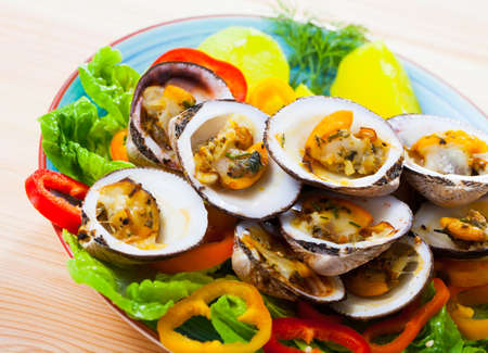 Baked in oven bivalve shellfishes