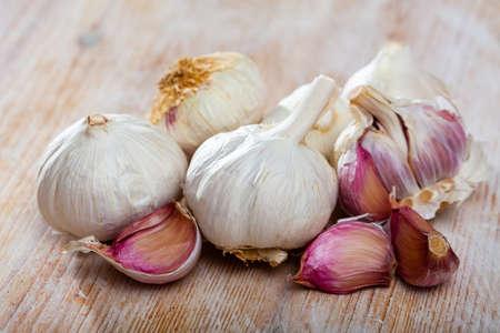 Raw bulbs and cloves of garlic