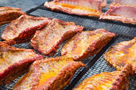 pork ribs preparing on grill brazier