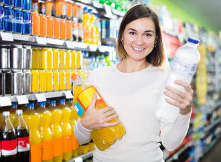 Girl customer looking for refreshing beverages