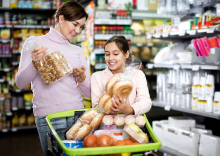 Woman with teenage daughter searching for bread