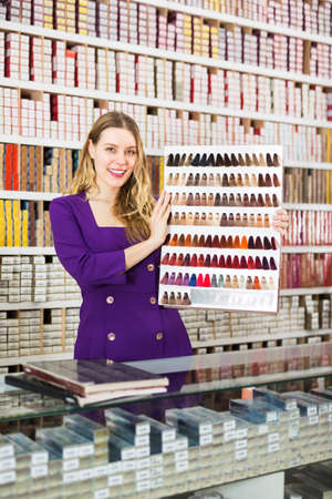 Saleswoman offering colors of hair dye