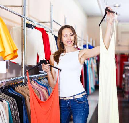 Woman choosing new dress