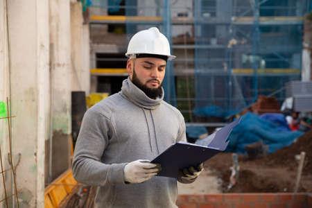 Engineer planning renovation works at building site