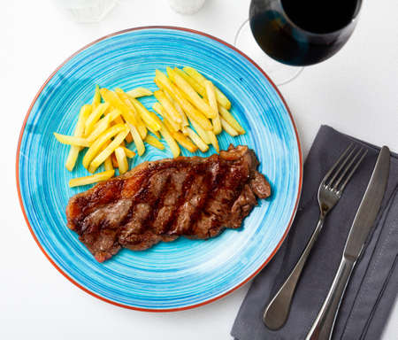 Tasty grilled beef tenderloin with french fries served